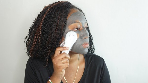 removing the elf magnetic charcoal mask with the wand