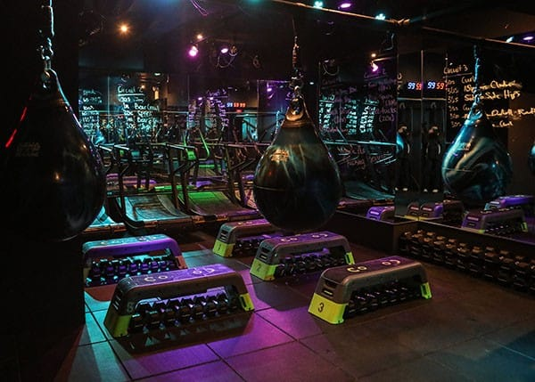Inside punch pedal house's boxing boot camp room